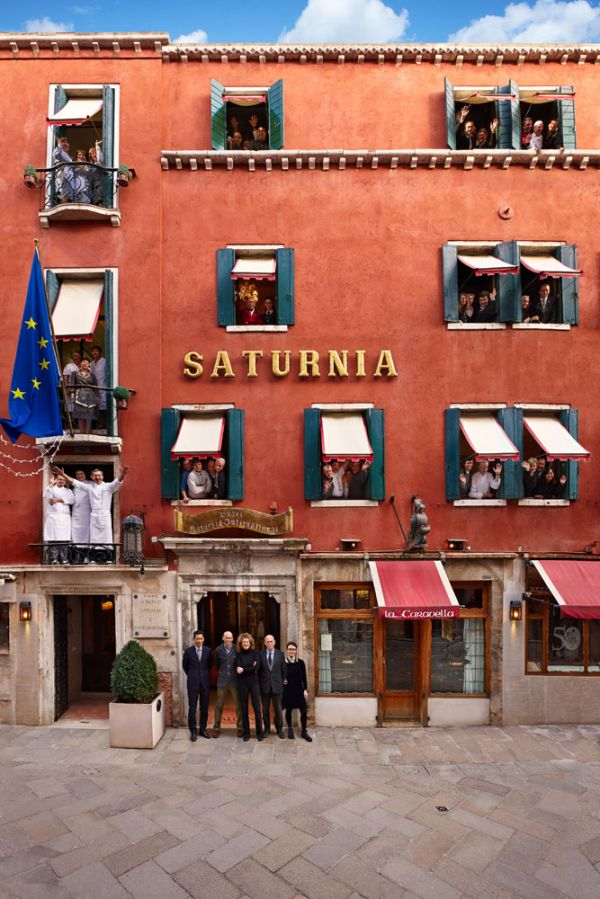 Staff and façade of Hotel Saturnia & International